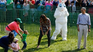 First lady Michelle Obama having fun with visitors to the White House Easter Egg roll