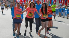 Celeste Corcoran (C) and her daughter Sydney (R) finish the race with Celeste's sister Carmen Acabbo.