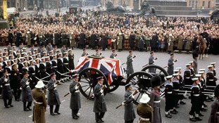 A gun carriage carries the coffin of Sir Winston Churchill across Trafalgar Square, London