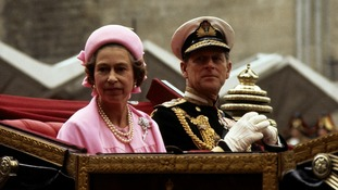 Queen Elizabeth II and the Duke of Edinburgh during a procession to celebrate the Silver Jubilee