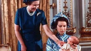 The Queen with Princess Anne and her 37 day old son Peter Phillips, at Buckingham Palace, after his christening.