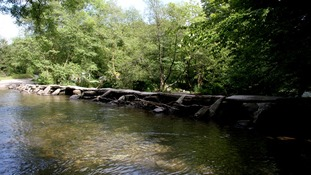 Tarr Steps is a prehistoric clapper bridge across the River Barle in the Exmoor National Park.