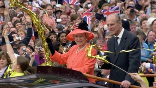 The Queen and the Duke of Edinburgh, ride along The Mall in an open-top car