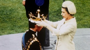Queen Elizabeth II crowning her son, Prince Charles, as Prince of Wales during the investiture ceremony at Caernarfon Castle