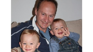 Gary Clarence pictured with his three-year-old twins.