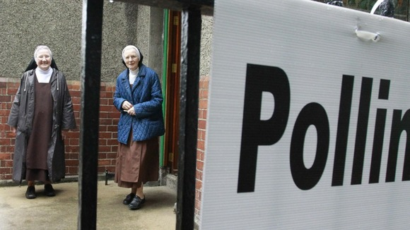 Carmelite nuns prepare to cast their vote in the European Fiscal Treaty Referendum at a polling station in north Dublin, Ireland.