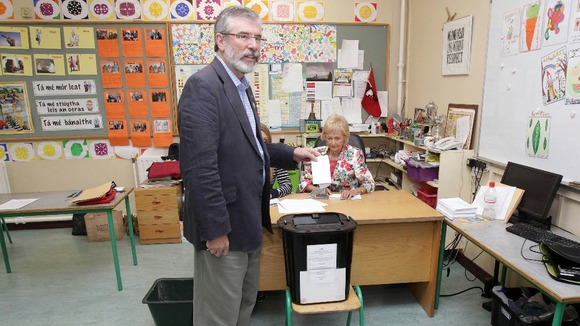 The Sinn Féin president Gerry Adam casts his vote.