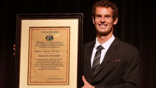 Wimbledon champion Andy Murray smiles widely as he holds the Freedom of Stirling.