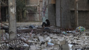 A Syrian rebel fighter rests among debris in Deir al-Zor, eastern Syria.