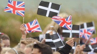 Cornish and Union flags are waved side-by-side.