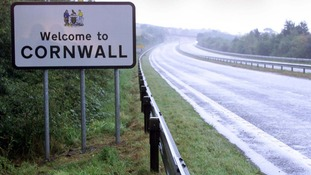 A sign reads 'Welcome to Cornwall'