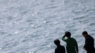 Relatives of passengers of the Sewol ferry look out to sea