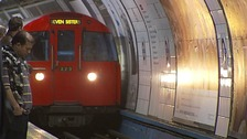 A tube train entering a station.