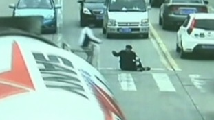A student comes to help the man who has been hit by a lorry