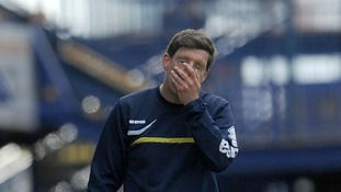 Bristol Rovers manager Darrell Clarke, who covered his faces during their match against Portsmouth, knows his team is under pressure.