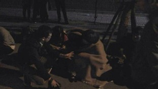 Family members camp outside the Malaysian Embassy.
