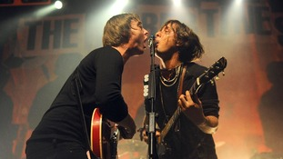 Pete Doherty (left) and Carl Barat of the Libertines performing on stage at the HMV Forum in Highgate, London