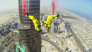 Daredevils base jump off world's tallest building setting new record