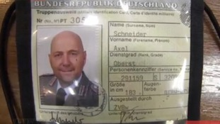An identity pass of a Dutch member of the OSCE group being held in Slaviansk.