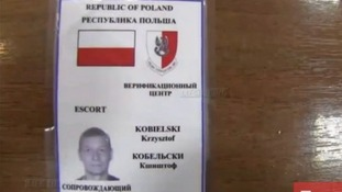 An identity pass of a Polish member of the OSCE group being held in Slaviansk.