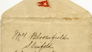 The envelope embossed with the White Star Line flag