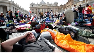 Pilgrims get their beds ready for the night as they camp out for the best spots in Saint Peter's Square.