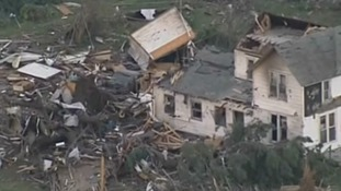 TV footage showing houses ripped off their foundations