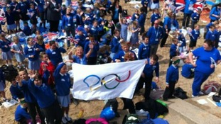 Children greet the torch in Crosby