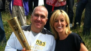 Granada Reports Correspondent Rachel Townsend gets close to the torch in Crosby