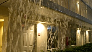 Heavy rain pours like a waterfall during a tornado storm in Tuscaloosa, Alabama.