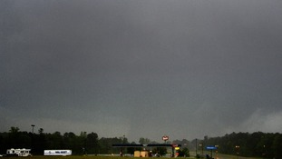 A large tornado is seen crossing the town of Louisville, Mississippi.