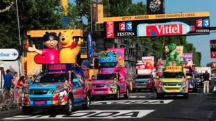 The Publicity Caravan makes its way along the Champs Elysees during the final stage of the 2013 Tour.