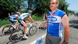 Dirk Nachtergaele, soigneur of team Quick Step holds a musette, during stage 10 of the 2010 Tour de France
