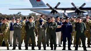 International aircrews involved in the search for missing flight MH370 prepare for official photograph.