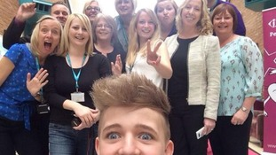 The MK College staff pose for a photograph with Bailey.