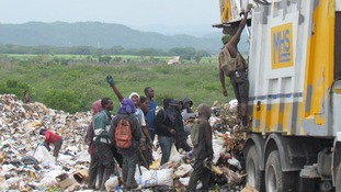 People rummage through rubbish in Riverton - one of the poorest areas in the country.
