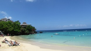 Holidaymakers relax at a Sandals Resort in Ocho Rios in northern Jamaica.
