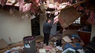 Theresa Long inside her destroyed house in Mayflower, Arkansas.