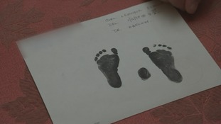 The only keepsake Elaine Joseph has of her daughter Tomika is a card with her footprints.