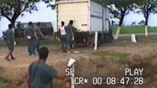 This rare footage was filmed in 1990s of one of the morgue trucks arriving for burial.