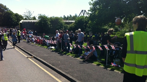 Crowds line the pavements as the torch arrives at Knowsley Safari Park