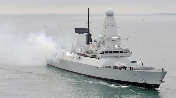 HMS Diamond outside Portsmouth Harbour firing a 21 gun salute.