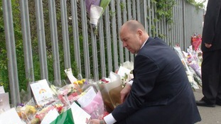 Headteacher Steve Mort with flowers left for Ann Maguire.