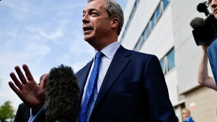 Nigel Farage speaking to media during his visit to Swansea today.
