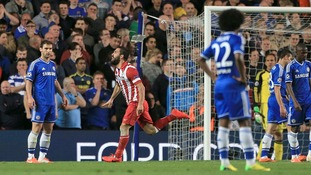 Chelsea fans watch on as Atletico celebrate their second goal.