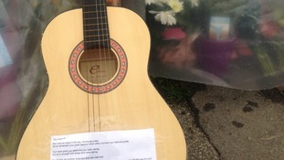 A guitar left outside the Leeds school where Ann Maguire was fatally stabbed.