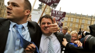 BNP leader Nick Griffin is rushed to his car after being egged in Westminster.