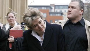 Former education secretary Ruth Kelly is hit by an egg outside Salford Magistrates Court.