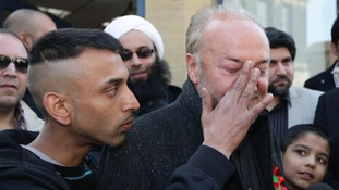 A supporter wipes egg from George Galloway's face after the Respect MP's by-election win in Bradford West.
