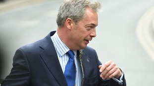 UKIP leader Nigel Farage is hit by an egg as he gets out of his car in Nottingham city centre